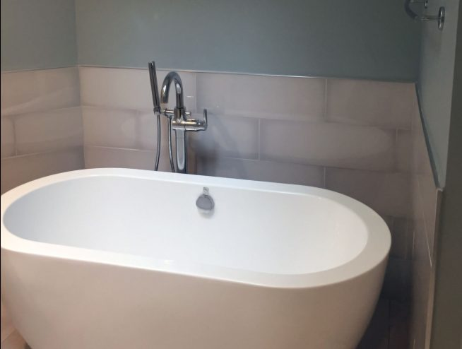 New plumbing and free standing tub