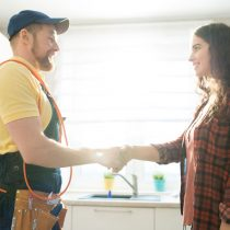 Plumber meeting with home owner
